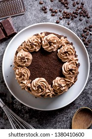 Mocha Layer Cake on dark surface with coffee beans and chocolate