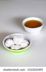 Mochi and a cup of tea on white background. Mochi is Japanese rice cake made of mochigome, a short-grain japonica glutinous rice.