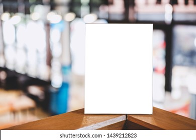Mock up acrylic frame posters pattern template forms background, blank menu frame on table in coffee shop or restaurant stand for your text of display your product.
