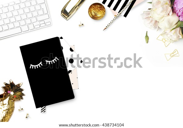 Mock up background, woman desk. Pink peonies, flower. Flat lay. Accessories on the table, view top, desk top modern. Notebook and gold stapler. Keyboard with pineapple