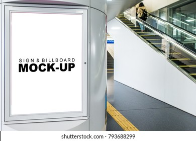 The mock up Billboard Banner signage with frame on metal pole, blank space display with clipping path use for information or advertisement in subway, blurred people used escalator