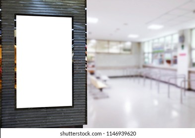 mock up of blank advertising light box or showcase billboard for your text message or media content in waiting zone for pay money and receive medicine at cashier pharmacy counter at hospital