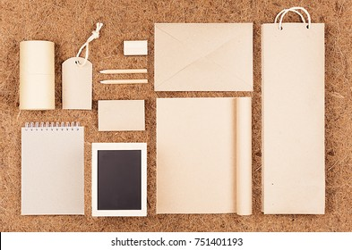 Mock up for of blank kraft recycled paper packaging and stationery on brown coconut fiber background.