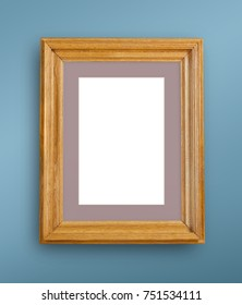 Mock up of blank photo frame on blue wall