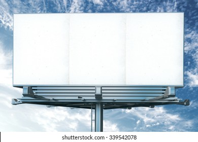 Mock up of blank white billboard on a background of blue sky