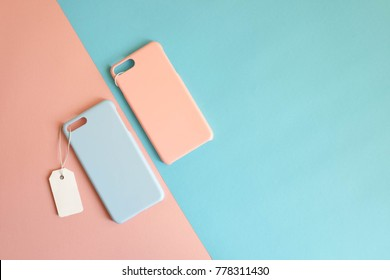 Mock up : Blue and pink pastel color of phone case with price tag on colorful background