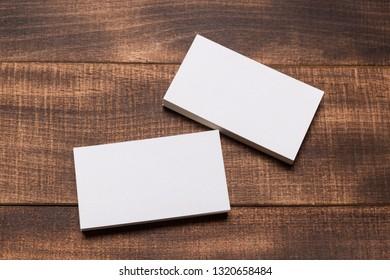 Mock up of business cards on dark wood background