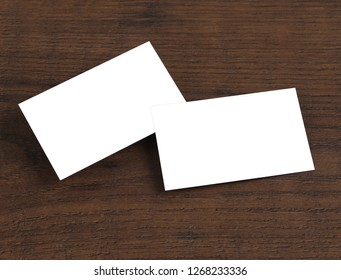 Mock up of business cards on wood background.