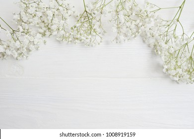 Mock up Composition of white flowers rustic style, for St. Valentine's Day with a place for your text. Flat lay, top view photo mock up
