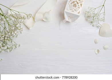 Mock up Composition of white flowers rustic style, hearts and a gift for St. Valentine's Day with a place for your text. Flat lay, top view photo mock up