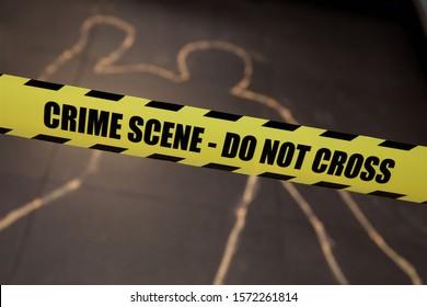 Mock crime scene with crime scene - Do Not Cross yellow ribbon and chalk body outline. Do Not Cross Crime Scene Police Tape, Bright Yellow with a Bold Black Print for High Visibility. Caution Danger