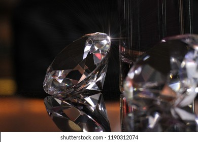 mock up daimond put on a table glass top showed its beauty reflexion