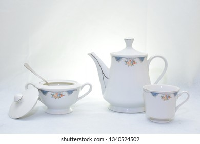 Mock up / design set of elegant and traditional teapot colorful white and blue coffee cup & Tea cup on cup's plate beside the hot tea pot , design/ drink-ware isolated on white background