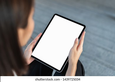 Mock up of female hand holding digital tablet blank screen on isolated. Take your screen to put on advertising.