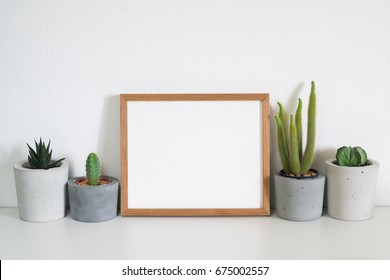mock up frame with cactus pot.cactus lover