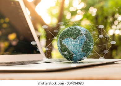 mock up the globe  with digital social media network on keyboard laptop computer in nature background