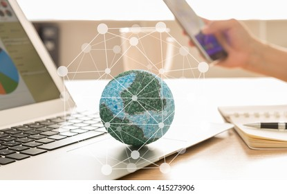 Mock up the globe with digital social media network on notebook at office background. Concept of Connection, Communication, Technology.
