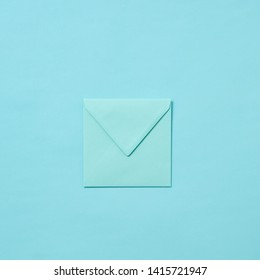 Mock up handmade envelope for greeting card or love letter on a pastel blue background with copy space. Top view.