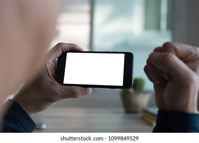 Mock up image, cheerful casual man or hipster using mobile smart phone watching tv channel at home. can be used for website or mobile application design