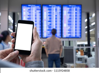 Mock up image. Man, traveler using blank screen smart mobile phone making online check-in via mobile apps with abstract blurred man checking flight at the international airport to travel on weekends.