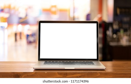 Mock up laptop with blank screen on table, Online shopping concept.