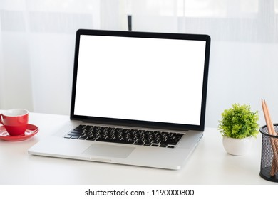 Mock up laptop with blank screen on desk.