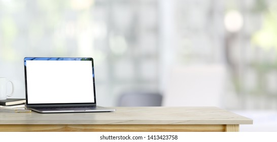 Mock up laptop on table in office