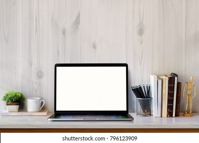 Mock up Laptop, stylish workspace creative supplies with blank screen laptop on marble desk.