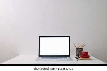 Mock up laptop, Workspace with blank screen coffee cup on a table