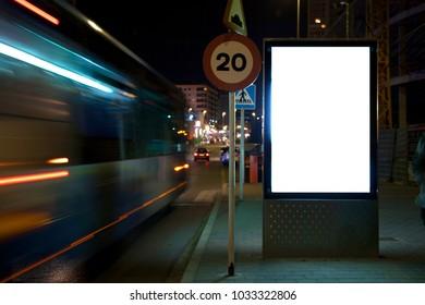 mock up of a light advertising box at a bus stop at night.