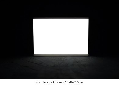 Mock up lightbox luminous display in the dark. Place for text or your design.