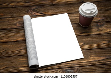 mock up a magazine and coffee on a brown wooden background. Clean sheet of the catalog for simulation and design of advertising, text.