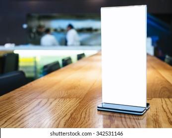Mock up Menu frame on Table in Bar restaurant cafe with Bartender