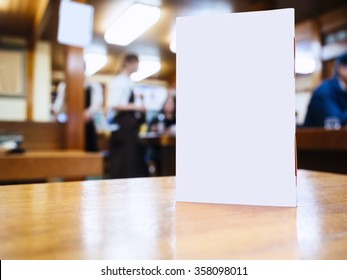 Mock up Menu frame on Table in Bar restaurant cafe Background with people