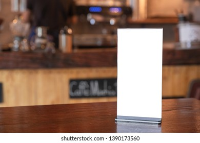 Mock up Menu frame standing on wood table in coffee shop. space for text.