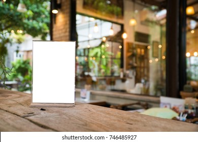 mock up menu object in cafe and restaurant,blank screen for booklet with white sheets of paper on wooden table on cafeteria,copy space for text or graphics object