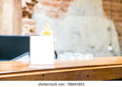 mock up menu object in cafe and restaurant,blank booklet with white sheets of paper on wooden table on cafeteria,promotion and information for business mock up.