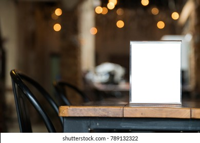 mock up menu object in cafe and restaurant,blank screen for booklet with white sheets of paper on wooden table on cafeteria,promotion and information for business mock up.