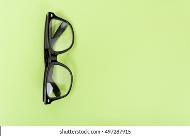 Mock up with modern glasses as smart concept on green background with advertising area