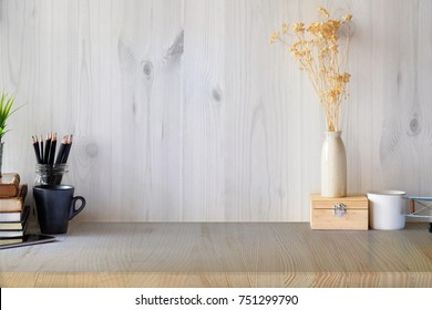 Mock up modern home decor with books, dummy, houseplant. Artist workspace with copy space for products display montage.