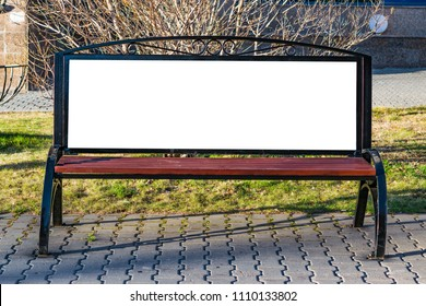 Mock up on a wooden bench in the city street, illuminated by the sun, cityscape