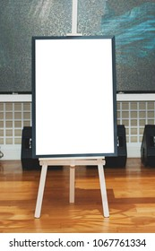 Mock up - painting on an easel at an exhibition or auction. Vertical photo.