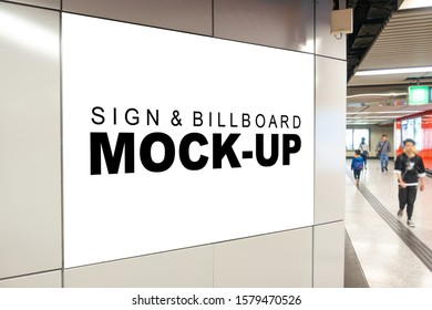Mock up perspective blank billboard with clipping path placed near entrance and walkway in metro station, blurred people walking, empty space for advertising or information, advertising concept