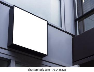 Mock up sign black frame Shop front display building exterior