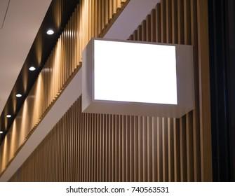 Mock up Signage Light box on wooden wall Shop logo