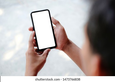 Mock up smartphone of hand holding black mobile phone with blank white screen
