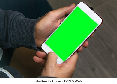 Mock up of smartphone held by the hands of a man. Template for corporate material