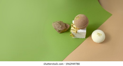 Mock up spa luxury products presentation. Bath bombs on gold texture podium on green and beige background. Minimal trendy design for branding of eco cosmetic treatment, wellness, health, skin care.