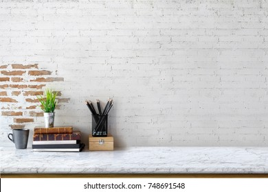 Mock up : Stylish minimalistic white marble table workplace with supplies, house plant. copy space for product display montage.