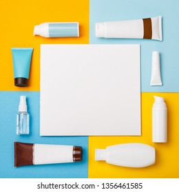Mock up summer skin care cosmetics on yellow and blue background. White bottles of woman cosmetics on yellow. Summer holidays or vacation. Preparation for summer care. Sunscreen protection  products